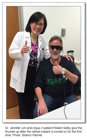 Dr. Jennifer LIm and Argus II patient Robert Selby give the thumbs up after the retinal implant is turned on for the first time. Photo: Sharon Parmet.