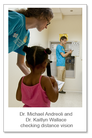 Dr. Michael Andreoli and Dr. Kaitlyn Wallace checking distance vision